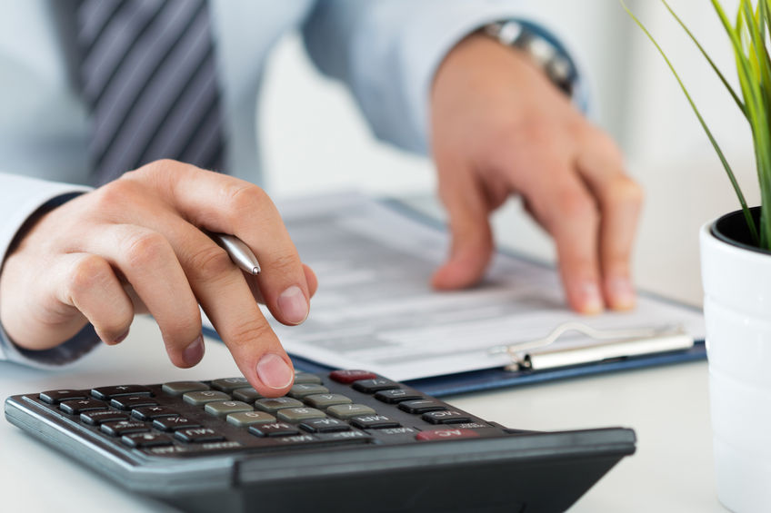 CPA Agent Calculating Taxes to Avoid IRS Seizure