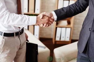 Two Businessmen Shaking Hands After an Agreement.