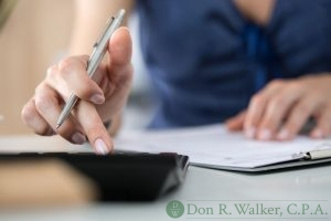 Female Accountant Using a Calculator.