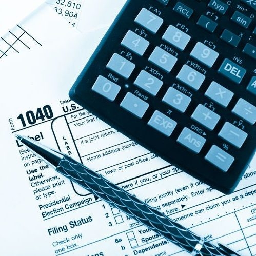 Income Tax Return With Pen & Calculator